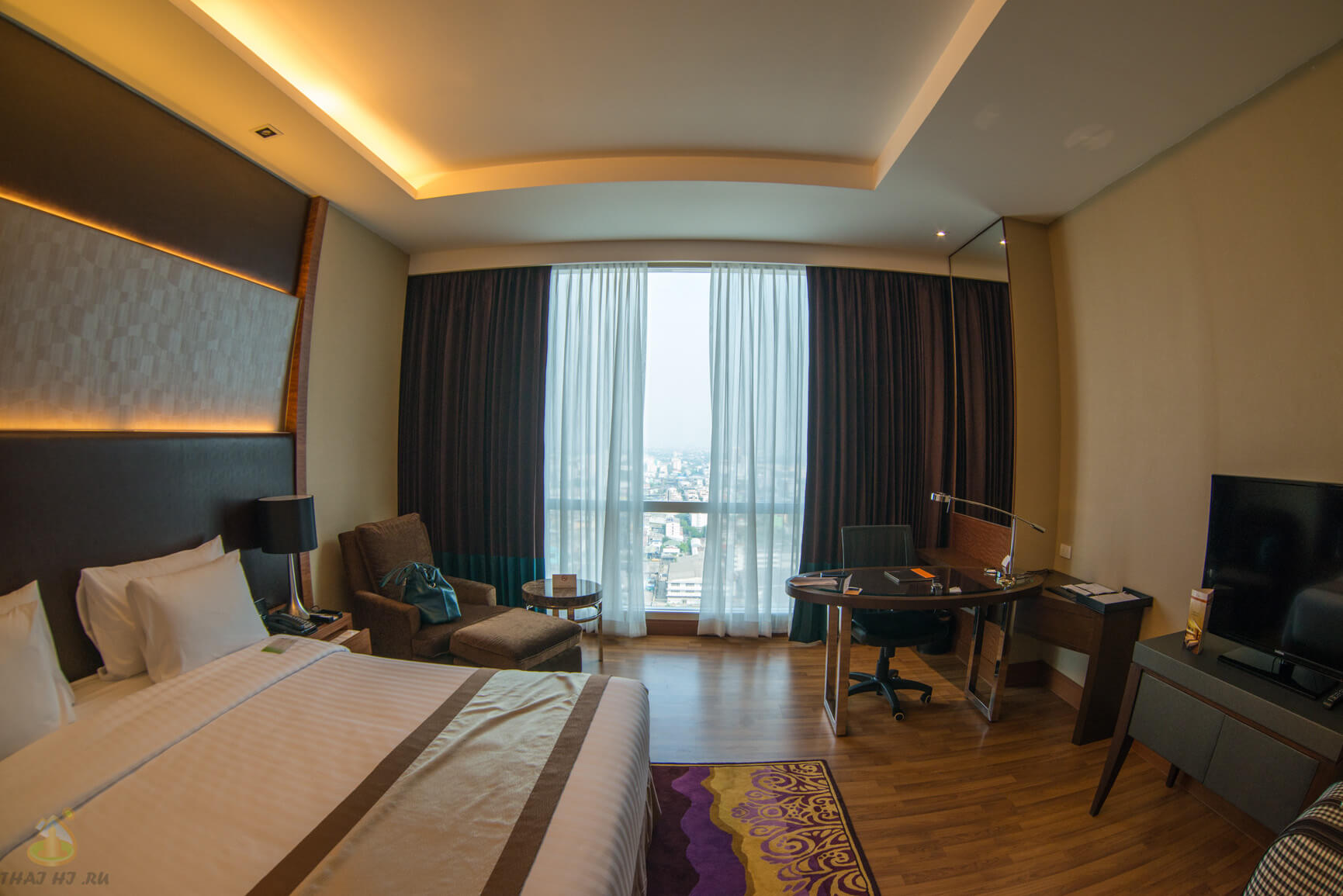 Deluxe номер в The Grand Four Wings Convention Hotel